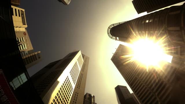 vidéos et rushes de la time-lapse: modern office arrière-plan cityscape avec ton chaleur sunrise - low angle view