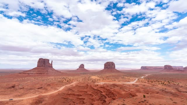 time-lapse monument valley navajo tribal park in utah usa - natural arch stock videos & royalty-free footage
