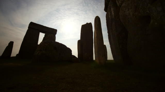 timelapse moon and clouds track over prehistoric stonehenge monument, wiltshire, uk - stonehenge stock videos and b-roll footage