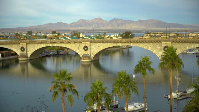 timelapse morning sunlight london bridge from england arizona - bridge built structure stock videos & royalty-free footage