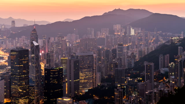 timelapse morning sunrise over hong kong city taken from victoria peak - mack2happy stock videos and b-roll footage