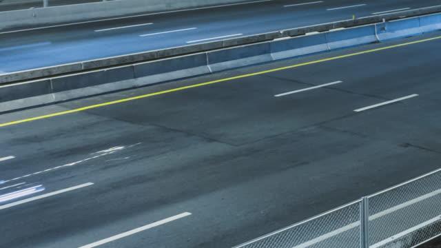 4k time-lapse : moterway traffic at night - tail light stock videos & royalty-free footage