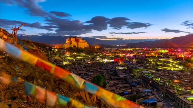 4k timelapse movie night to sunrise scene of shigatse monastery, shigatse, tibet, china - traditionally tibetan stock videos & royalty-free footage