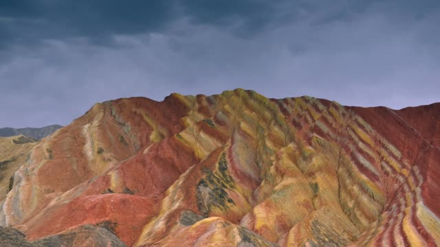 timelapse movie of moving cloud at  zhangye danxia national geopark, gansu, china. colorful landscape of rainbow mountains - mountain range stock videos & royalty-free footage