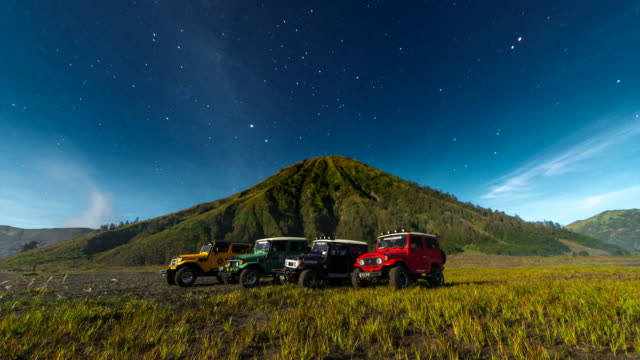 4k timelapse moving star night scene around of mts. bromo, semeru, batok and widodaren, tengger caldera, indonesia - tengger stock videos & royalty-free footage