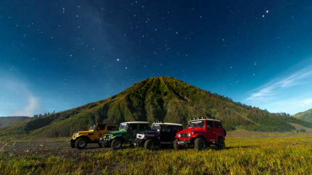 4k timelapse moving star night scene around of mts. bromo, semeru, batok and widodaren, tengger caldera, indonesia - mount bromo stock videos & royalty-free footage