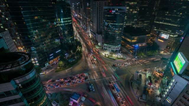 timelapse night scene of light trails traffic speeds through an intersection in gangnam center business district of seoul at seoul city, south korea. - south korea stock videos and b-roll footage