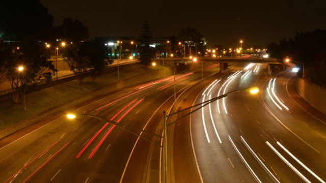 time-lapse night scenery of road at australia - street light stock videos & royalty-free footage