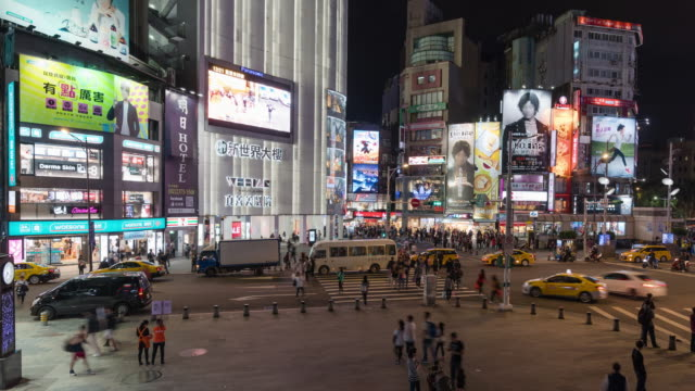4k time-lapse: night time-lapse people crowd and traffic in ximending shopping district, taipei city taiwan. panning shot - taipei video stock e b–roll