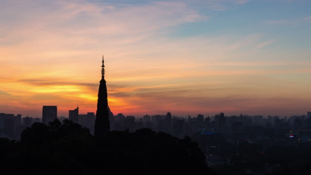 4k time-lapse night to day:sun rising over hangzhou downtown skyline,china - hangzhou stock videos & royalty-free footage