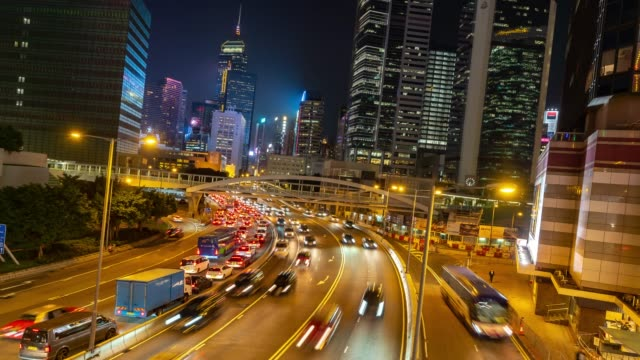 time-lapse: night traffic in central and admiralty hong kong highway with skyline building cityscape in background - central district hong kong stock videos & royalty-free footage