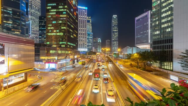 time-lapse: night traffic in central and admiralty hong kong highway with skyline building cityscape in background - land vehicle stock videos & royalty-free footage