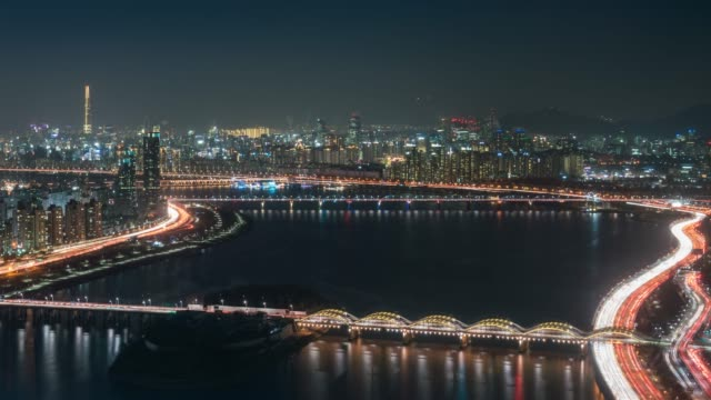 Timelapse night view of bridge cross over Han river from Yeouido business district