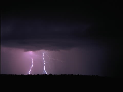 timelapse nighttime lightning storm - artbeats stock videos & royalty-free footage