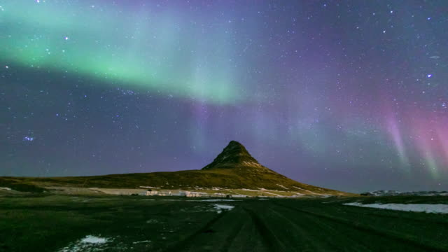 4k time-lapse: northern light aurora borealis at kirkjufell iceland - dramatic sky stock videos and b-roll footage