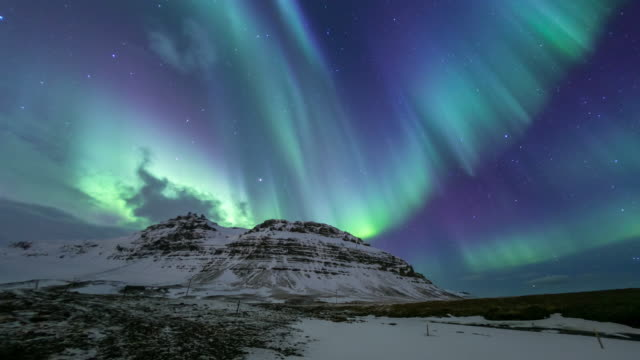 4k time-lapse: northern light aurora borealis at kirkjufell iceland - light natural phenomenon stock videos & royalty-free footage
