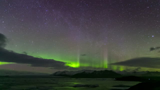 4k time-lapse: northern light aurora borealis vatnajokull glacier jokulsarlon iceland - icecap stock videos and b-roll footage
