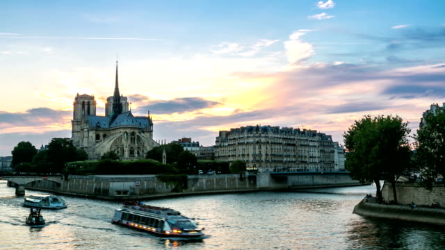 hd timelapse: notre dame cathedral at dusk in paris, france - river seine stock videos & royalty-free footage