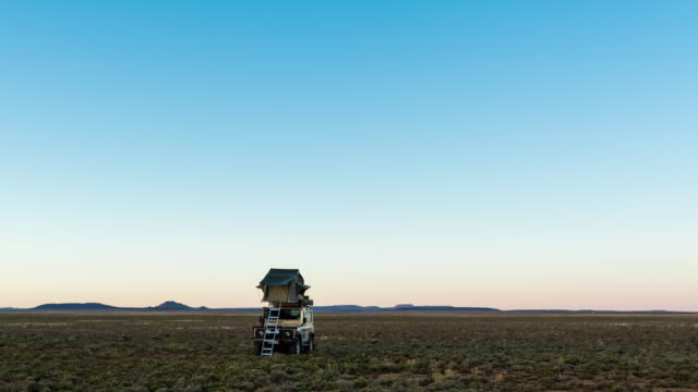 timelapse of a 4x4 vehicle in the karoo at sunrise - karoo bildbanksvideor och videomaterial från bakom kulisserna