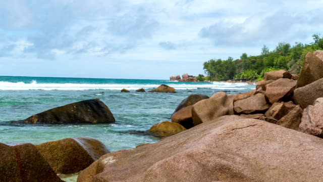 timelapse of a beach in la digue - seychelles - pjphoto69 stock videos & royalty-free footage