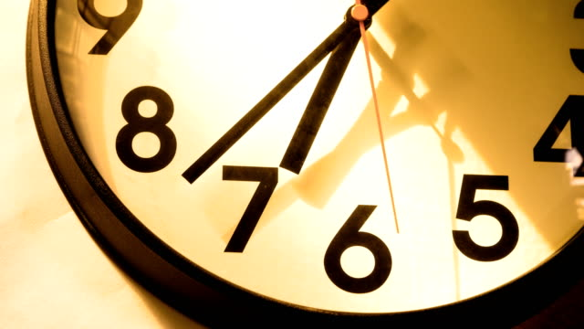 t/l 4k timelapse of a clock at 7 o'clock / going to night - clock stock videos & royalty-free footage