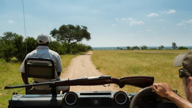 timelapse of a game ranger sitting on a tracker seat - 公園保安官点の映像素材/bロール