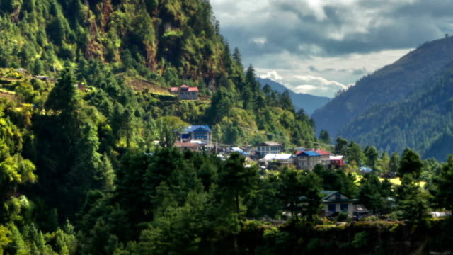 stockvideo's en b-roll-footage met time-lapse of a himalayan valley with a river and a small village. cropped. - valley