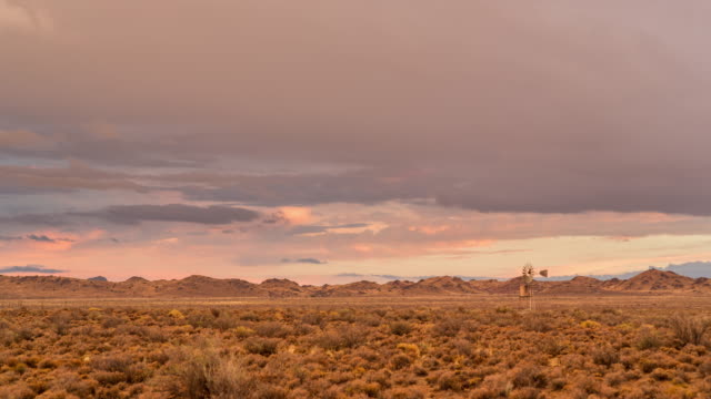 Timelapse of a Karoo farm landscape with a windmill