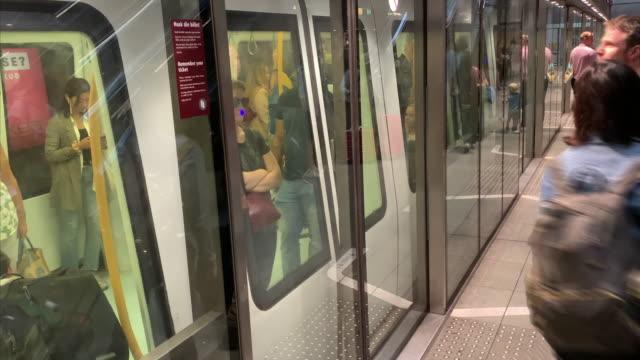 time-lapse of a metro train picking up passengers at underground station, copenhagen - öresundregion stock-videos und b-roll-filmmaterial