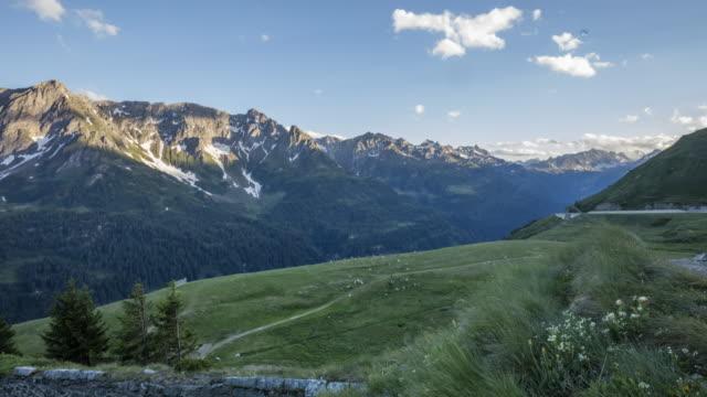 vidéos et rushes de timelapse of a mountain valley with livestock - alpes suisses