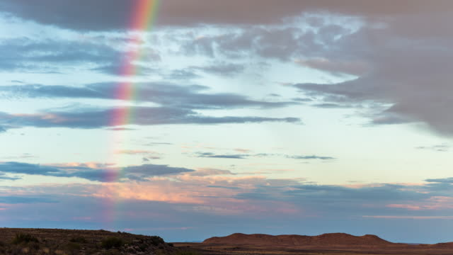 Timelapse of a rainbow over a Karoo landscape at sunrise