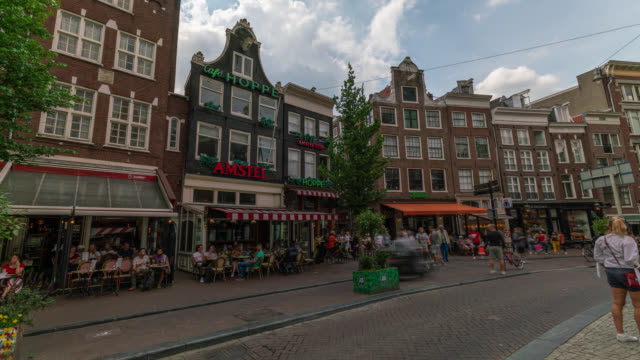 timelapse of a small square in amsterdam - amsterdam stock videos & royalty-free footage