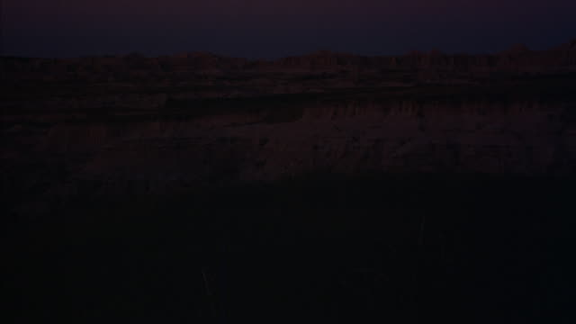 time-lapse of a south dakota canyon ridge at golden-hour. - badlands national park stock videos & royalty-free footage