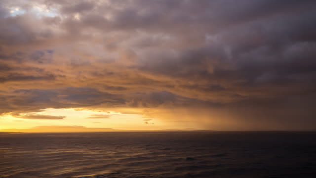timelapse of a storm in the north sea - stimmungsvoller himmel stock-videos und b-roll-filmmaterial