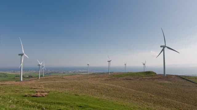 Time-lapse of a wind farm in Scotland showing wind turbines both turning and re-orientating into the wind direction from day to night