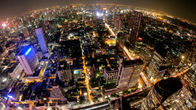 Timelapse of Aerial view of night scene of Bangkok skyline.