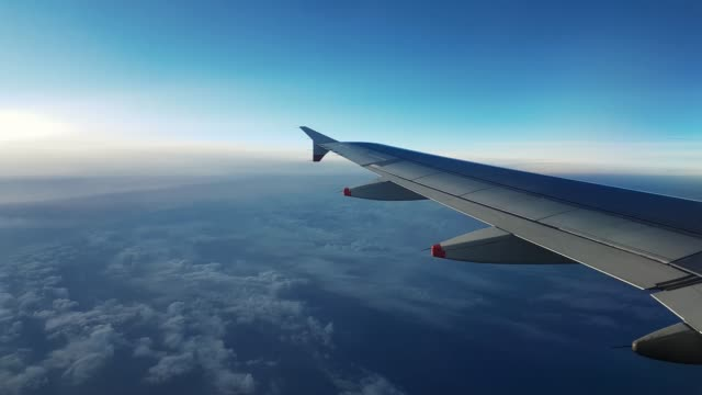 4K Timelapse of Aeroplane Wing View Window Late Evening at 40000ft cruising 3840x2160