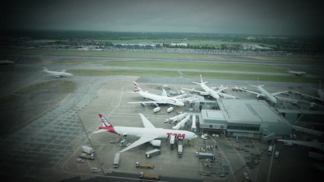 timelapse of aeroplanes taxxiing at heathrow airport - vignette stock videos & royalty-free footage