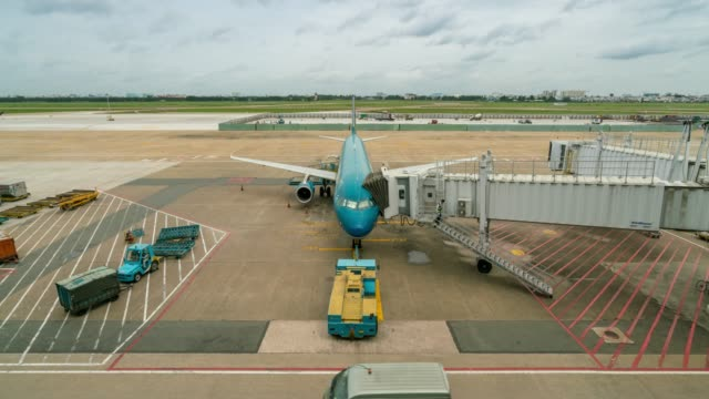 timelapse of airplane depart at gate - aerospace industry stock videos & royalty-free footage
