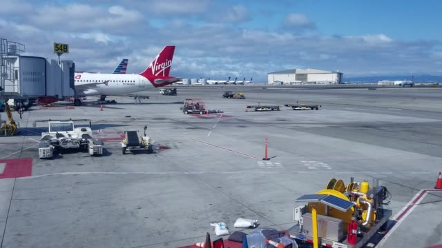timelapse of airport tarmac outside terminal 2 at san francisco international airport in san francisco, california, with airplanes taxiing and taking... - san francisco international airport stock videos & royalty-free footage