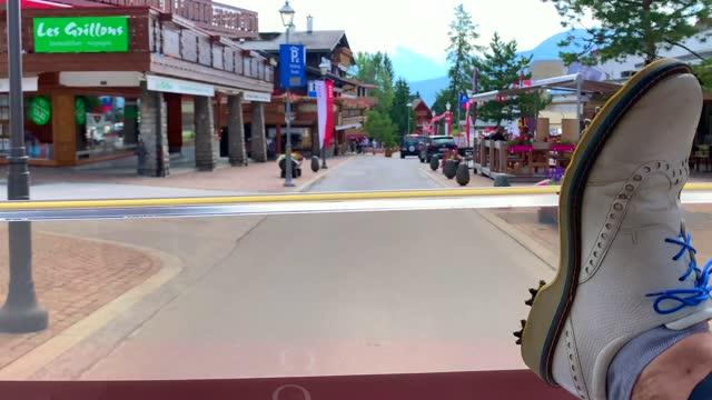 timelapse of an electric golf cart riding on crans sur sierre golf course in crans montana on august 01, 2021 in valais, switzerland. - street name sign stock videos & royalty-free footage