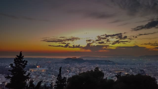 timelapse of athens panorama in greece. a panoramic view of athens and piraeus from the hill of lycabettus at sunset - lycabettus hill stock videos & royalty-free footage