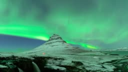 Timelapse of aurora borealis or nothern light at Kirkjufell in iceland