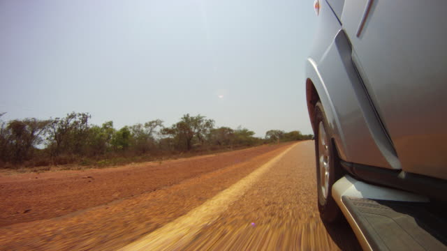 Timelapse of Australian road with a car in the righthand frame