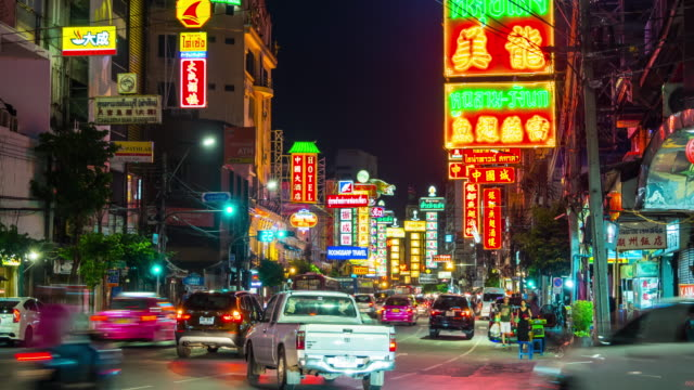 timelapse of bangkok city traffic in chinatown at night - chinatown stock videos and b-roll footage