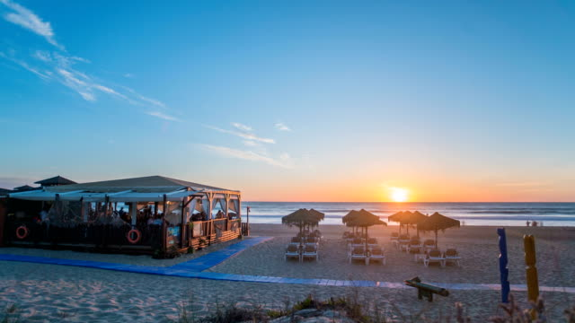Timelapse of beach restaurant at sunset