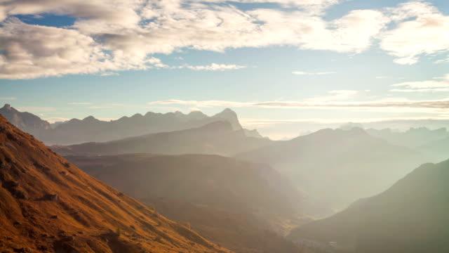timelapse of beautiful sunrise from passo pordoi. dolomites, italy - mountain pass stock videos & royalty-free footage