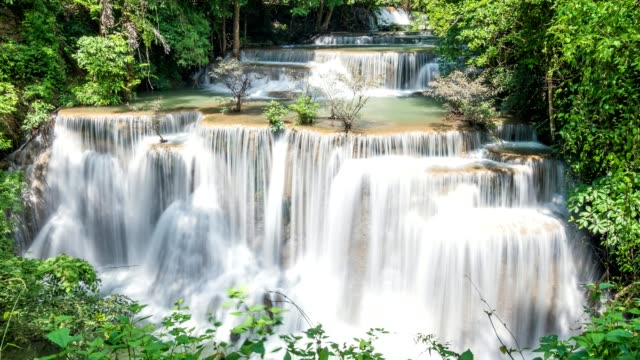 time-lapse of beautiful waterfall in tropical rainforest at national park. huai mae khamin 4 floor - flooring stock videos & royalty-free footage