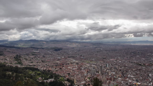 Timelapse of Bogota cityscape with moving clouds
