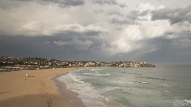 4k timelapse of bondi beach, nsw, australia - moody sky stock videos & royalty-free footage